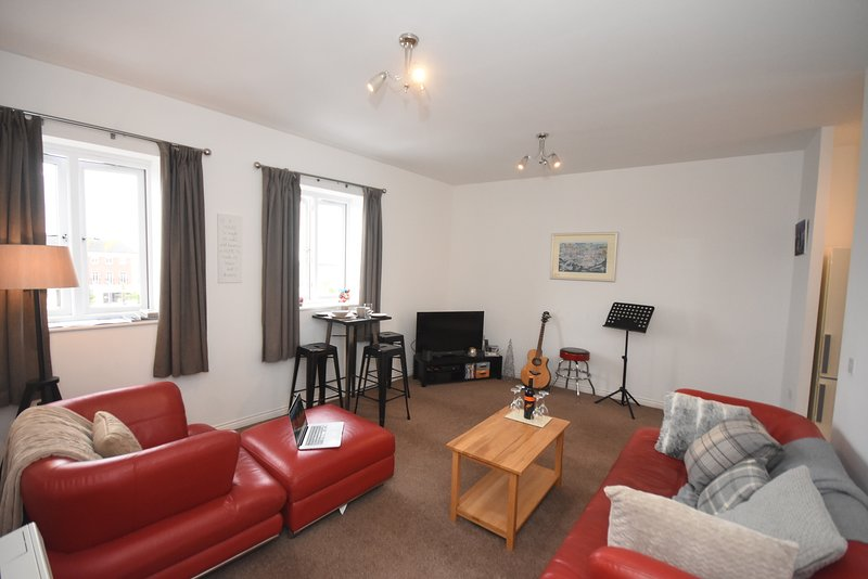 Bright, airy and spacious living area with open plan aspect to the kitchen to the right