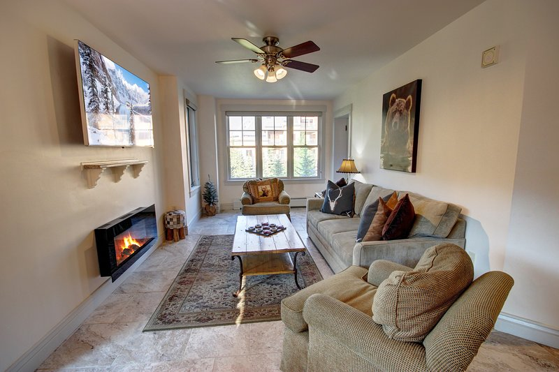 Cozy living room with lots of seating.