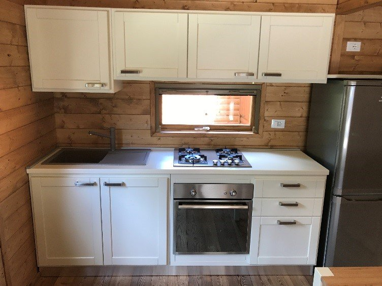 kitchenette with kitchen and attrenzatura, refrigerator, table with chairs
