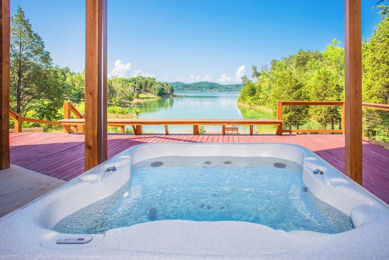 Hot tub in the balcony with an amazing nature and lake views