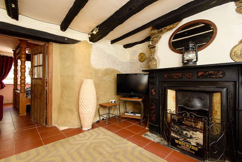 Con originale carattere soffitti con travi a vista abbonda in questo delizioso cottage