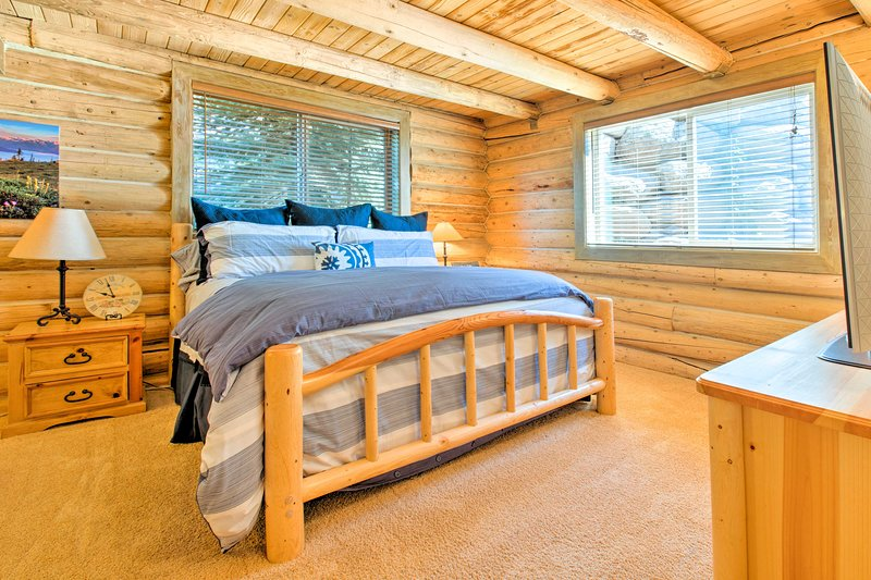 All 5 bedrooms are framed by large windows and log siding.