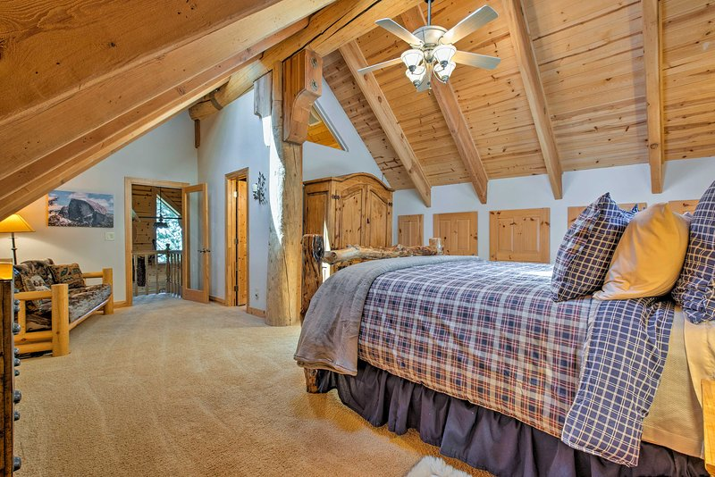 The master bedroom boasts a king bed and plenty of storage space.