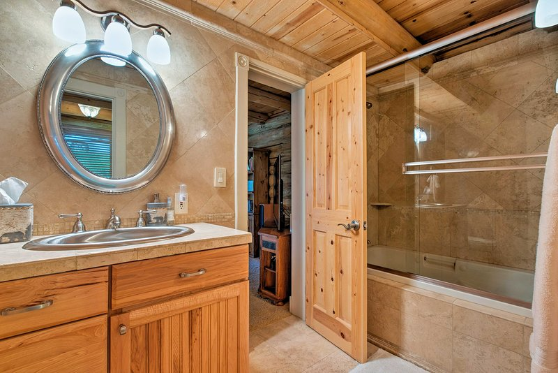 There are 5.5 bathrooms featured throughout the cabin.