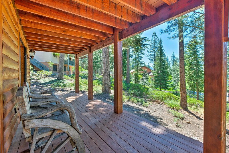 Enjoy the fresh scent of pine from the furnished deck.