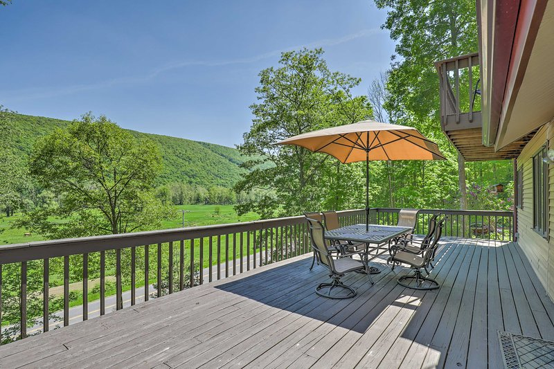 The house boasts a spacious deck and a hot tub overlooking Italy Valley.