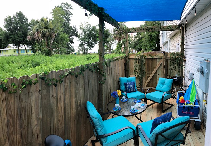Enjoy a relaxing conversation in the covered enclosed private patio