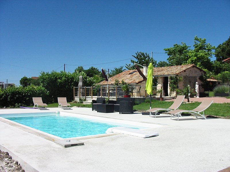 Private terrace of Gite with furniture,BBQ and private pool.