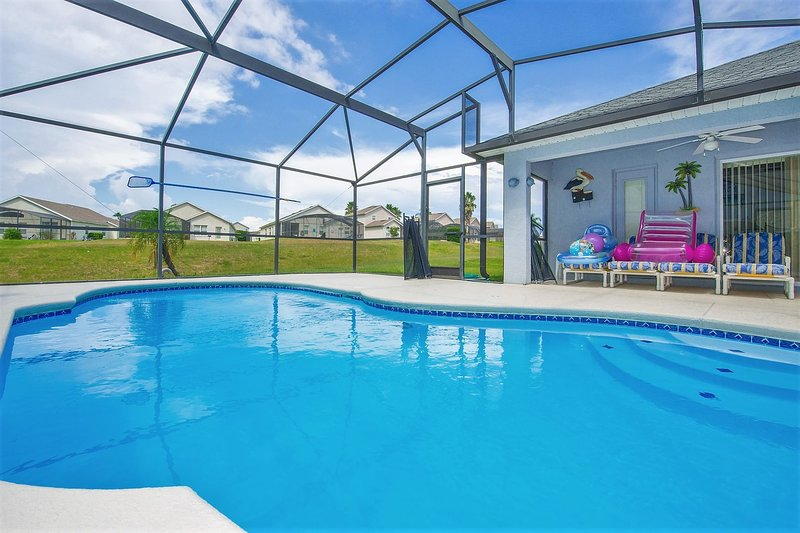 Sunny private pool with extended pool deck; soak up that glorious Florida sunshine!