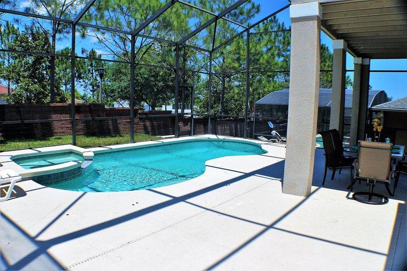 Lanai con comedor al aire libre con vistas a la piscina y spa, The Hamlet, Davenport
