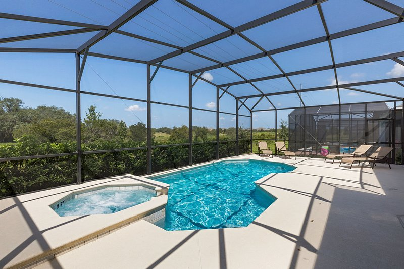 Sunny, spacious pool deck with resort style sun loungers