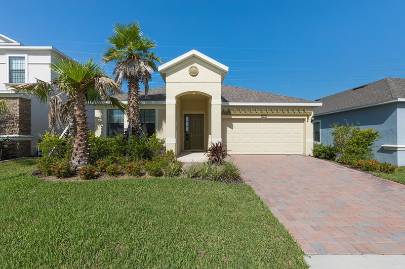 Modern, spacious Florida villa with south facing pool.  Sleeps 8 in comfort and style