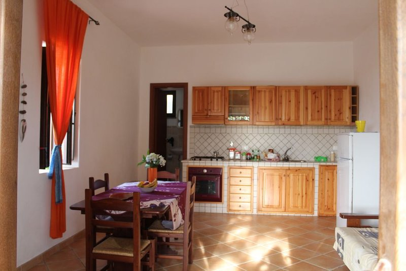 living room with kitchenette and sofa bed