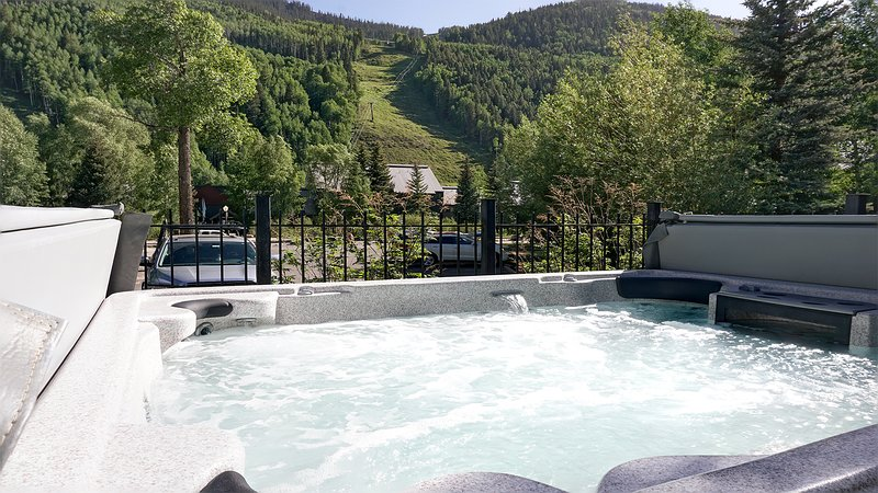 Common use 10 person outdoor hot tub with views of Telluride Ski Resort