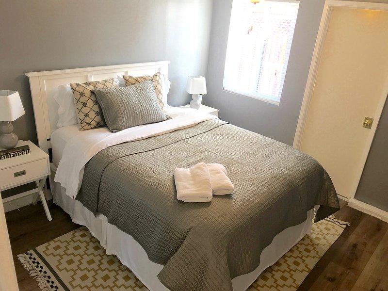 Bedroom 1 - queen bed, exterior door onto porch