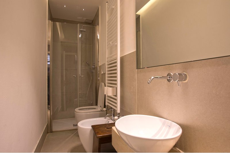 Elegant bathroom with a shower and free toiletries included