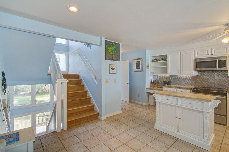 Área de cocina, electrodomésticos de acero inoxidable