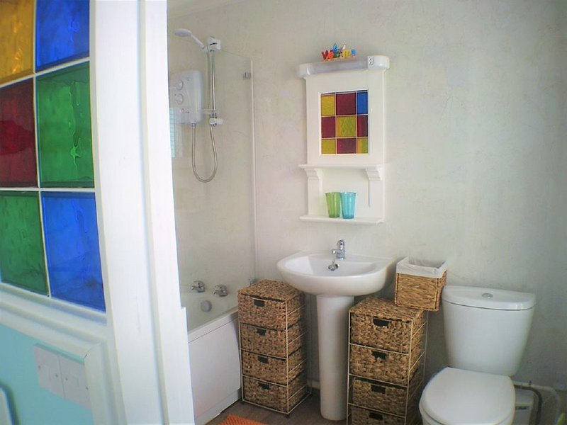Ensuite Bathroom with bath an shower
