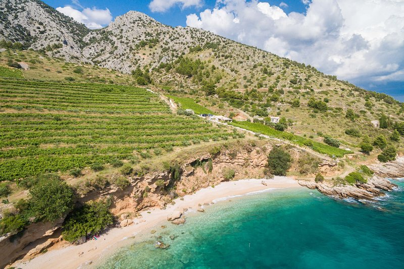 Paradise Beach Retreat 2 Bedroom Villa Nestled in Vineyards Near Bol, Croatia!, vacation rental in Bol