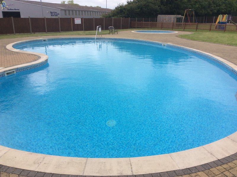 Free outdoor pool adjacent to property