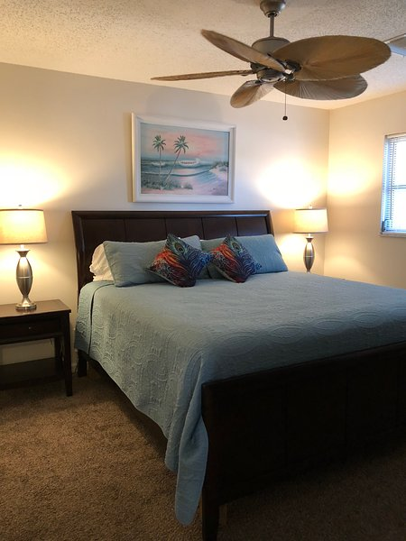 Comfortable king sized bed with a high dresser with cable tv. huge walk in closet.