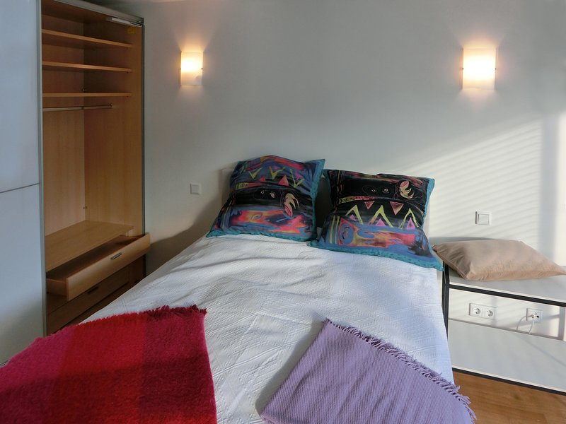 Comfortable box spring bed and a sliding door wardrobe