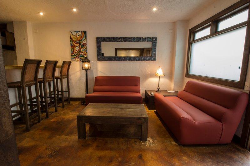 Large Living Room. Adjacent Bar Seating, Kitchen, Large TV.
