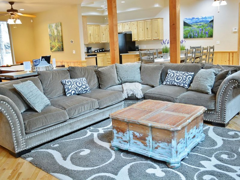 In the main living room area, you will find a large, comfortable couch for you to lounge on. Kick of