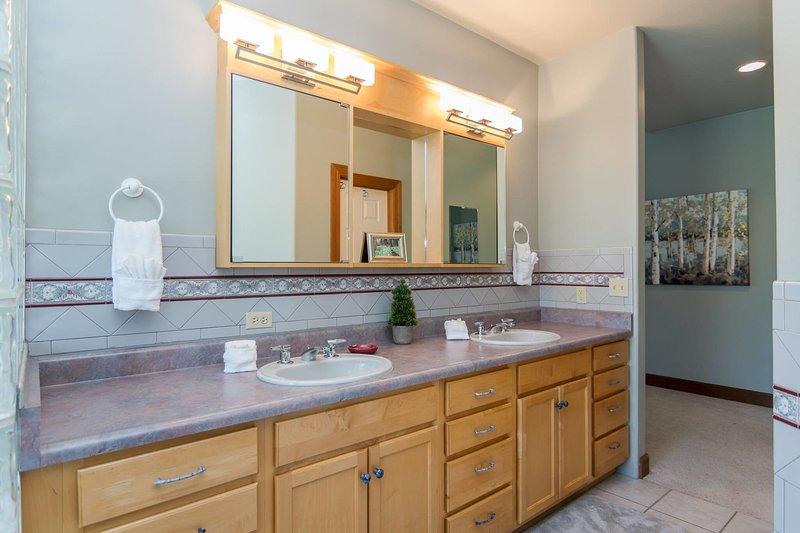 Dual sinks in the en suite bathroom (main level)