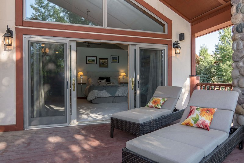Unwind on the deck accessed from the main level  Master suite