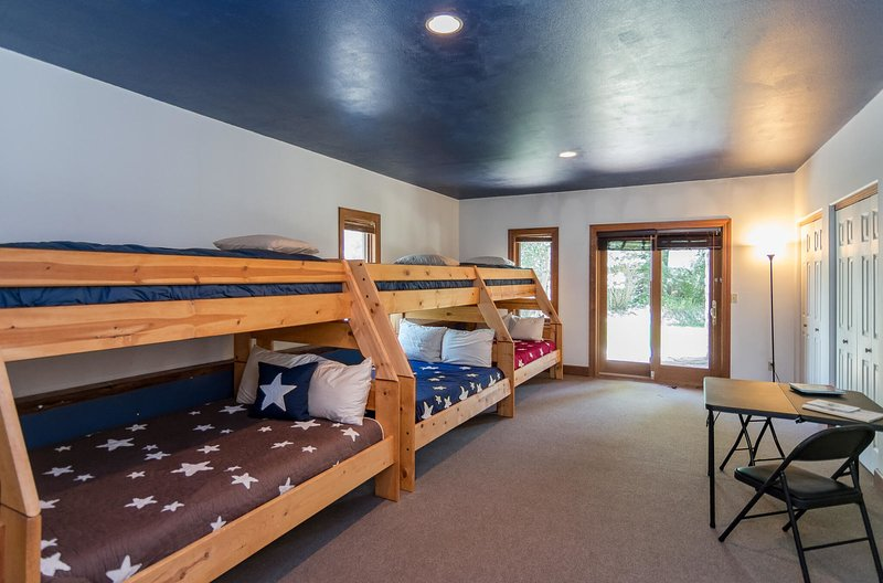 Fifth bedroom with 3 sets of twin-over-full bunk beds (lower level)