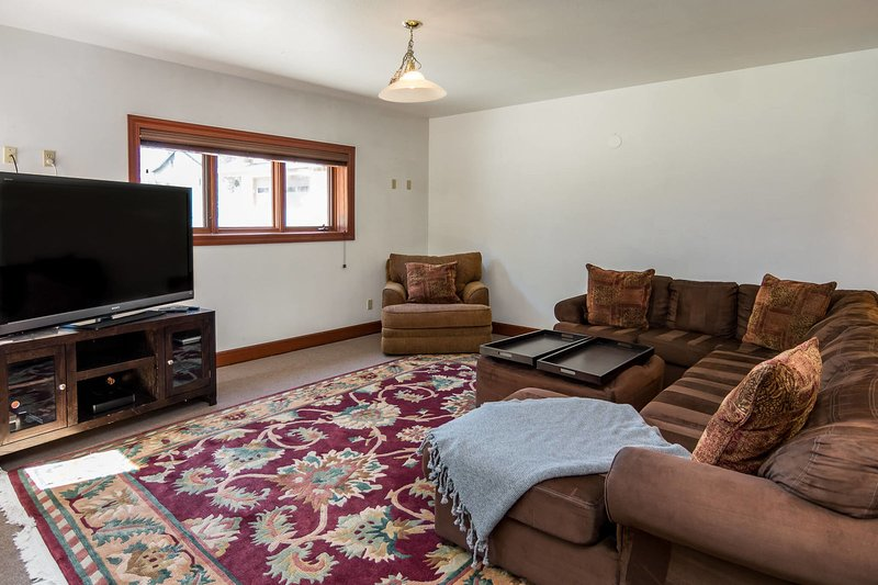 Lower level lounge with abundant seating around the flat screen TV