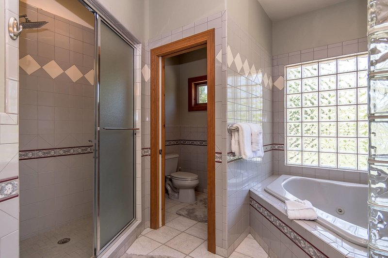 Jetted tub and oversized shower in the en suite bathroom