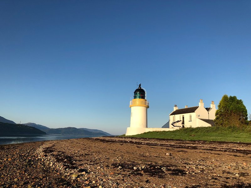Corran Point Lighthouse and Lodge at sunrise