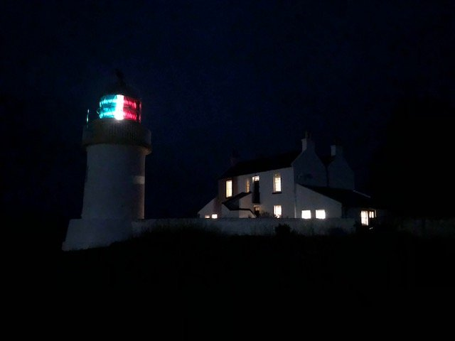 Corran Point Lighthouse and Lodge by night