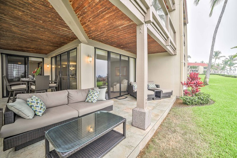 The vacation rental condo sits just feet from the shore with an expansive deck.