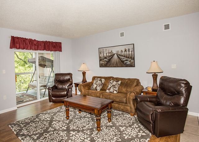 Spacious Living Room with 2 Leather Recliners and Sofa