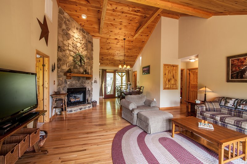 Main Level Living Room with Views, Stone Fireplace, Vaulted Ceilings, Flat Screen TV