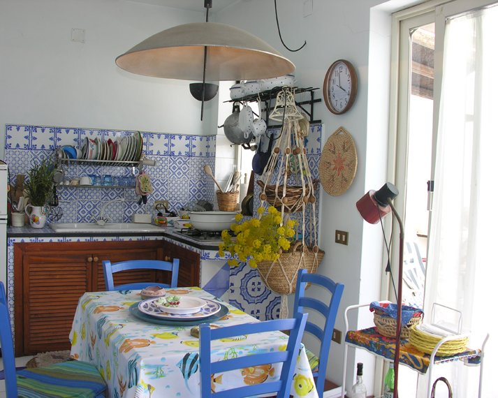 Kitchen equipped with all utensils and washing machine on the terrace