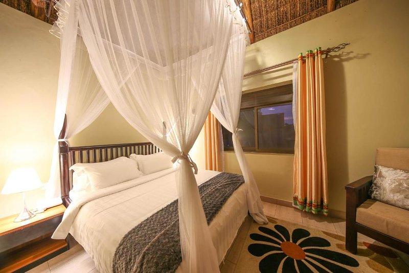 TRIPLE ROOM (Bedroom 1), location de vacances à Bugala Island
