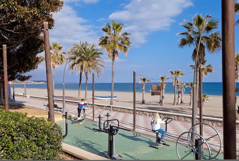 Beautiful promenade of Estepona beside the beach