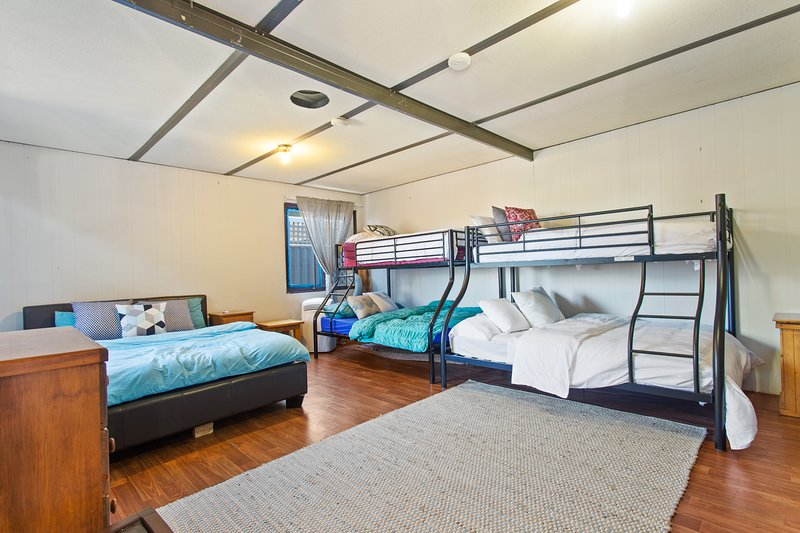Granny flat Bedroom 4 - Sleeps 8 people but also has 3 extra roll out mattresses and 2 cribs