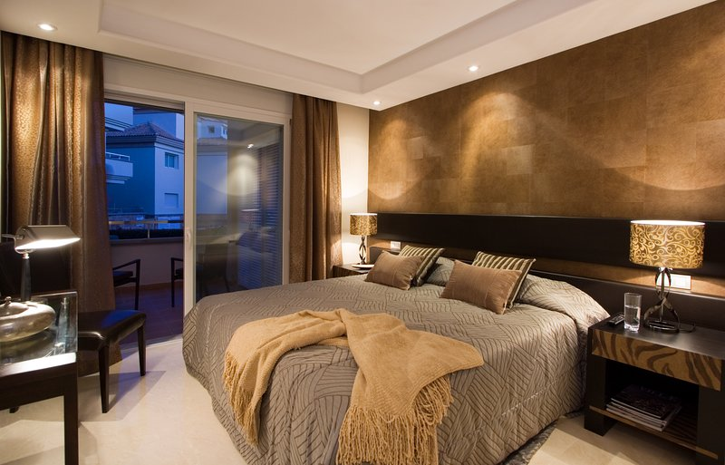 Master bedroom with ensuite bathroom leading directly onto outdoor terrace