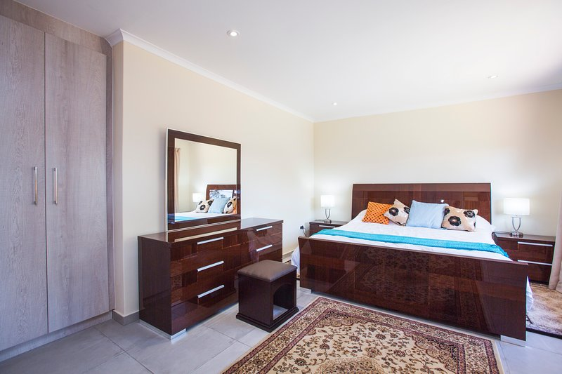 The Main Bedroom  with king size bed and flat screen TV.