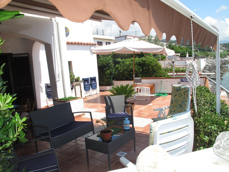 VIEW TERRACE FROM THE BARBAQUE shaded area and sona sun protected if necessary by large UMBRELLA.