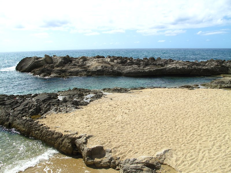 BEACH on Tyrrhenian Sea protected from waves with natural rocks that form NATURAL POOLS