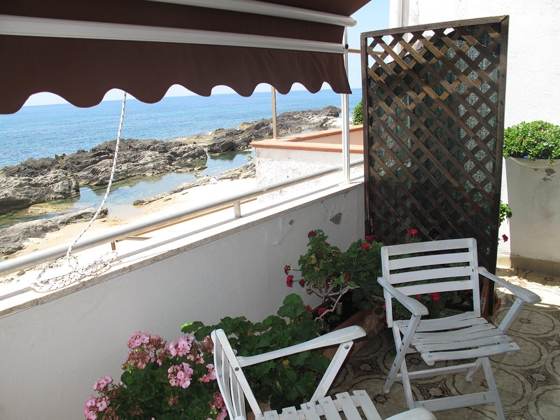 PANORAMIC BALCONY with Solar awning and small armchairs.