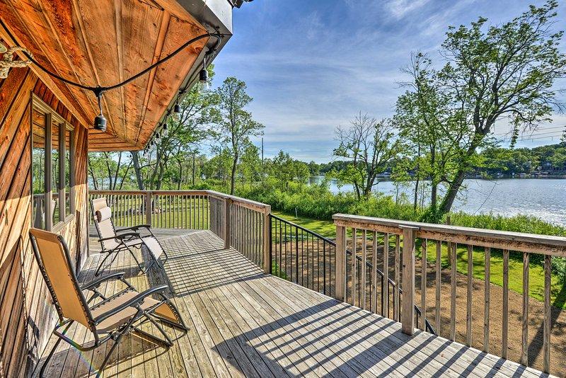 The 360-degree wrap around porch offers beautiful lake views!