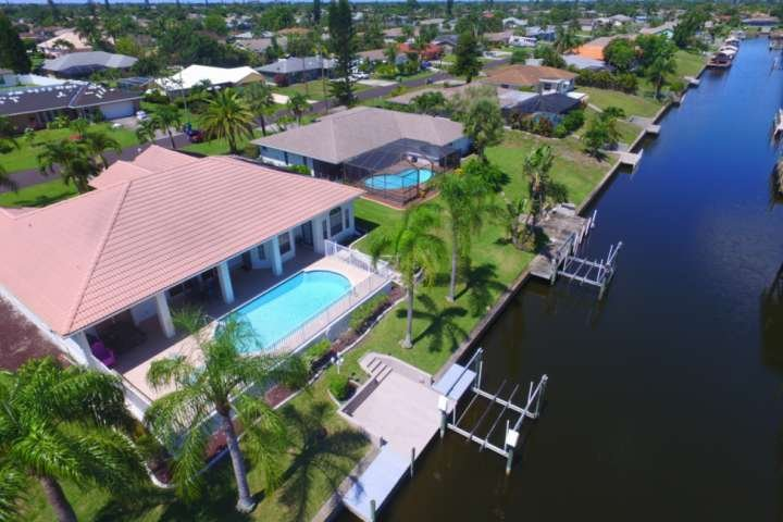 Come live the SW Florida dream in this stunning and stately Gulf access pool home in desirable South East Cape Coral.