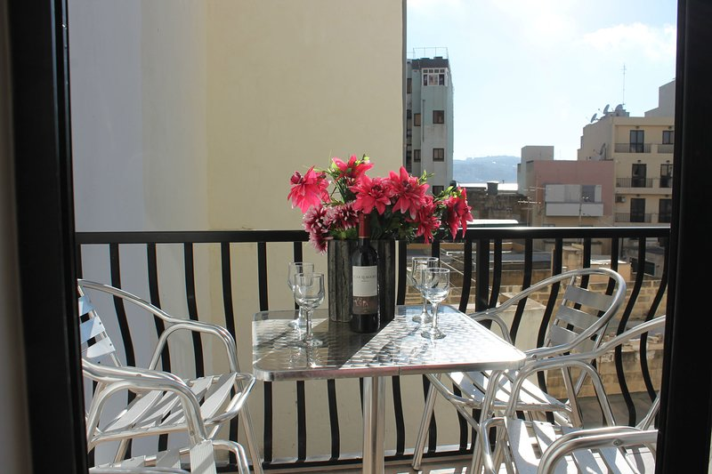 Sunny Back Terrace with Table and Chairs